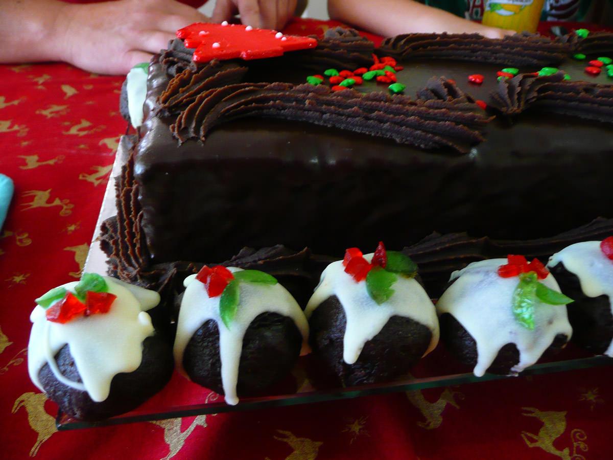 Christmas chocolate cake and mini Christmas puddings