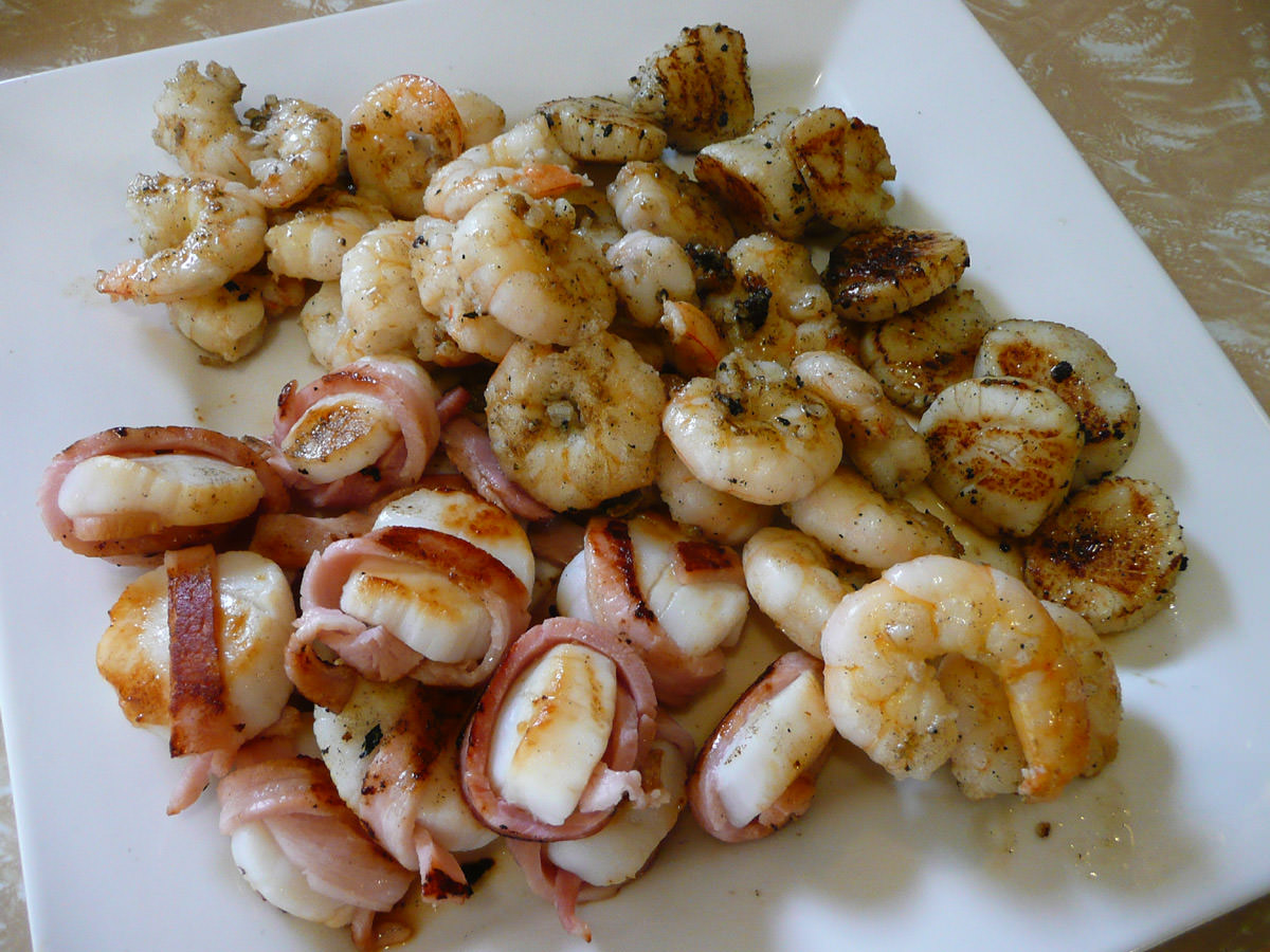 Scallops wrapped in bacon, garlic and oil prawns, garlic butter scallops