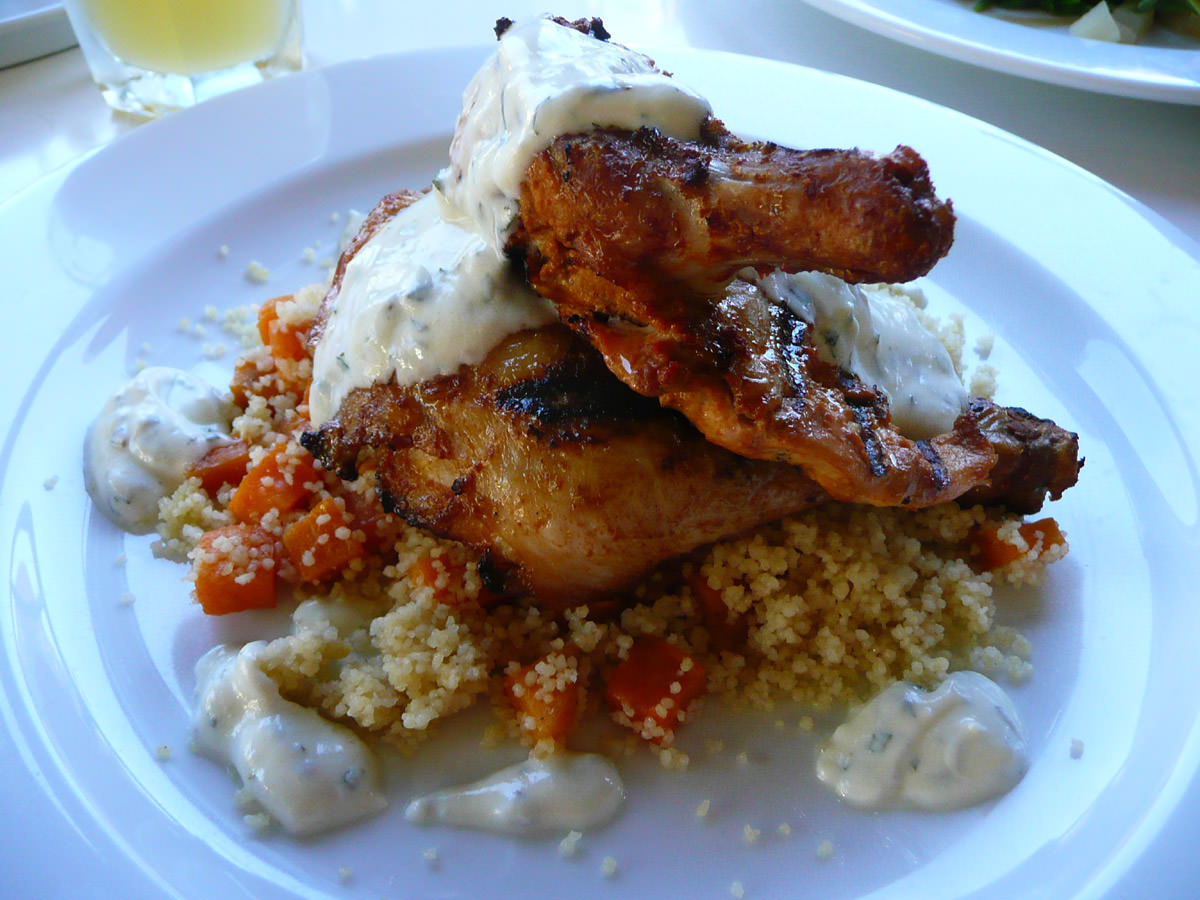 Peri peri spiced chicken with orange scented cous cous, roasted sweet potato and yoghurt dressing
