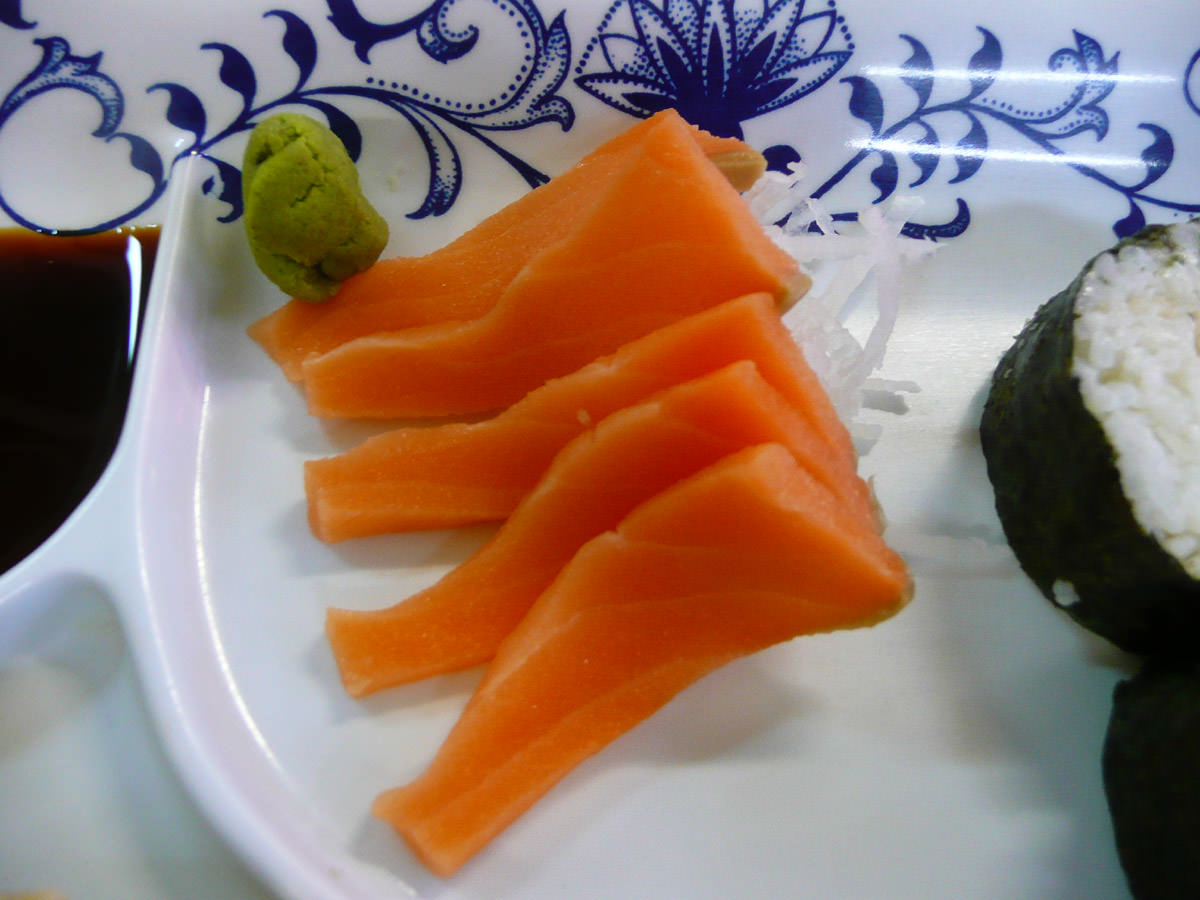 Salmon sashimi with a ball of wasabi