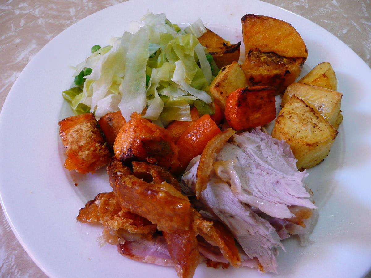 Roast pork, crackling and vegetables