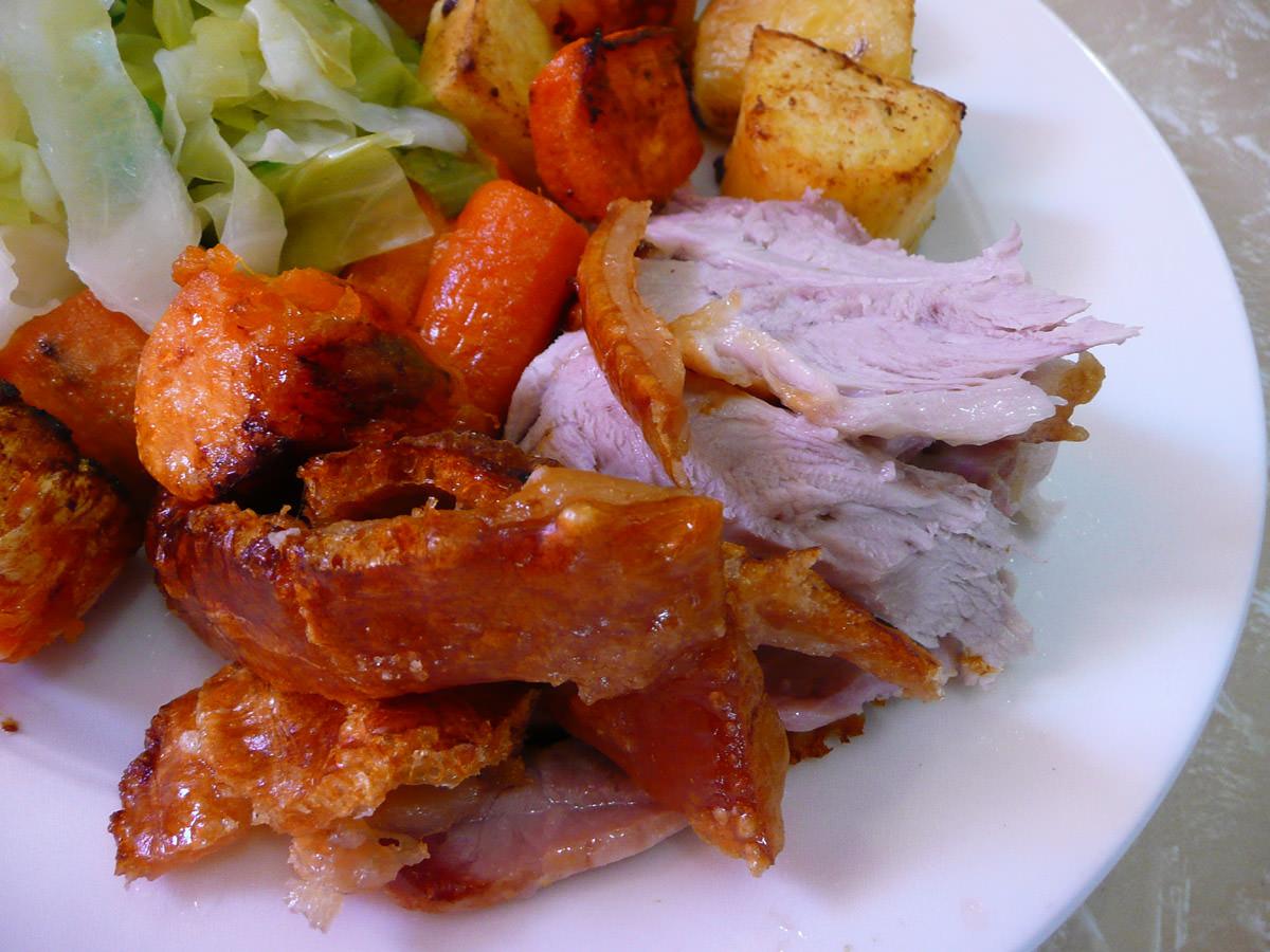 Roast pork and crackling close-up