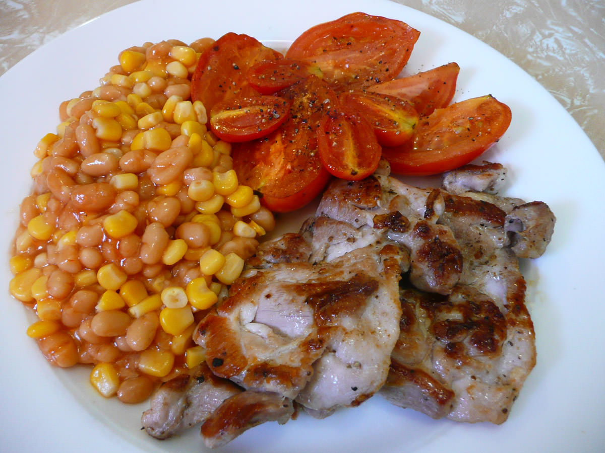 Celery salt chicken, baked beans and corn, panfried tomato