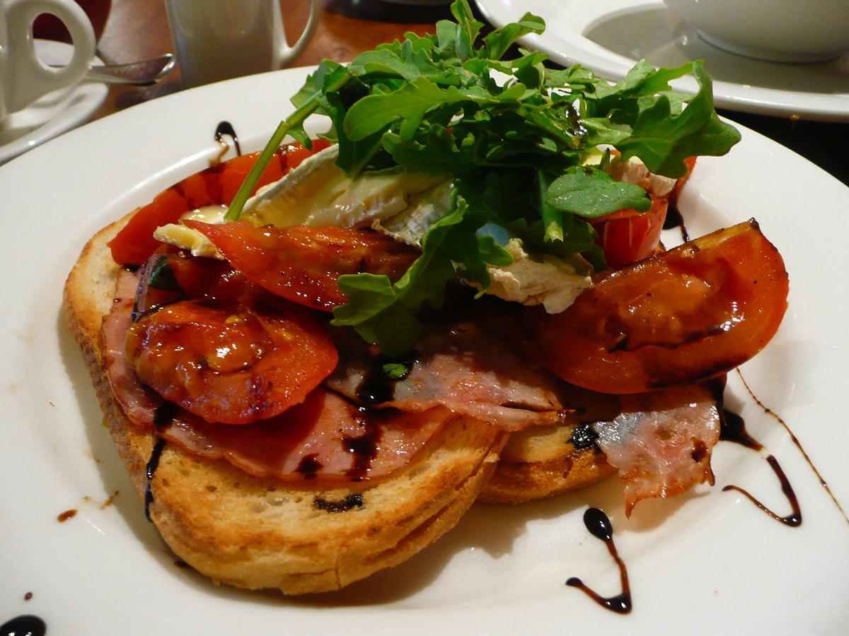 Honey glazed ham, roasted roma tomatoes and brie on toast