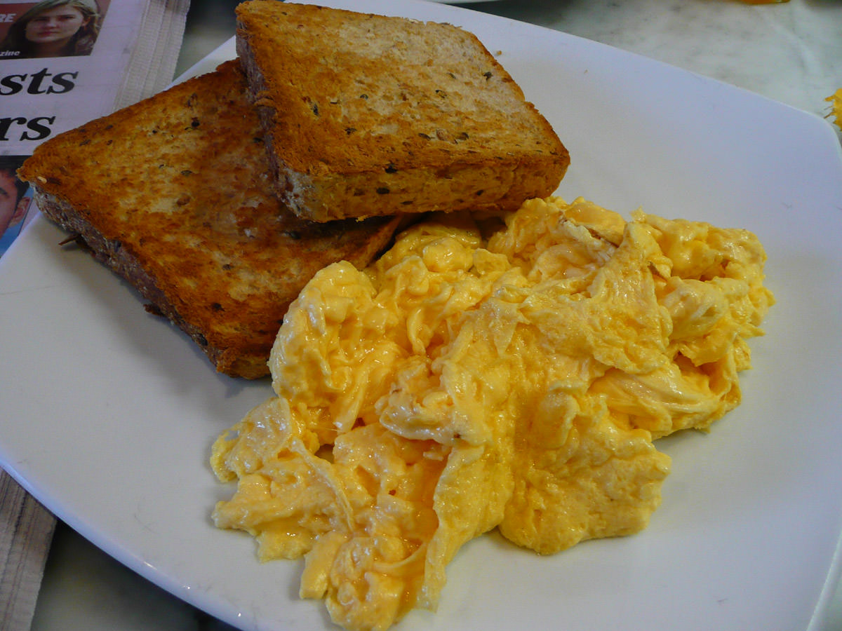 Scrambled eggs on multigrain toast