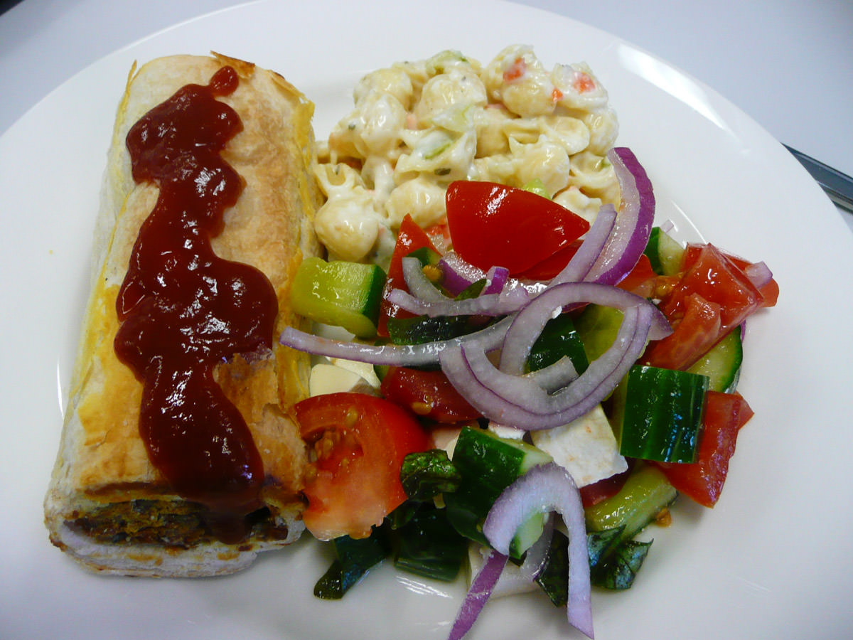 Sausage roll and sauce, greek and pasta salads