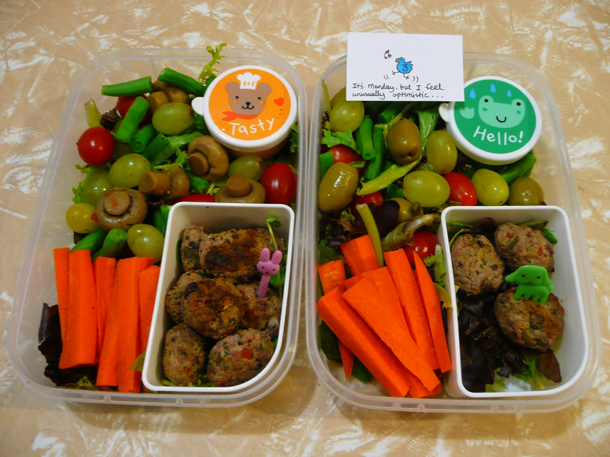 Hers and hers bento lunches with lamb meatballs with salad