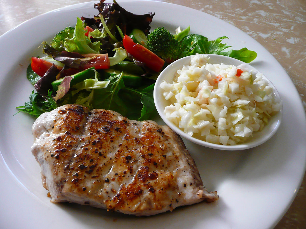Panfried snapper with salad and KFC coleslaw