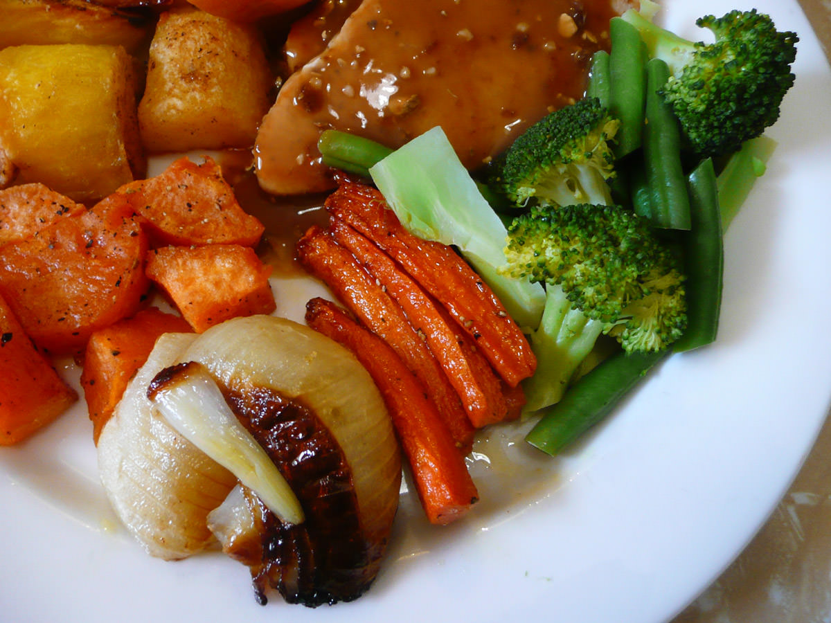 Roasted vegetables and steamed broccoli close-up