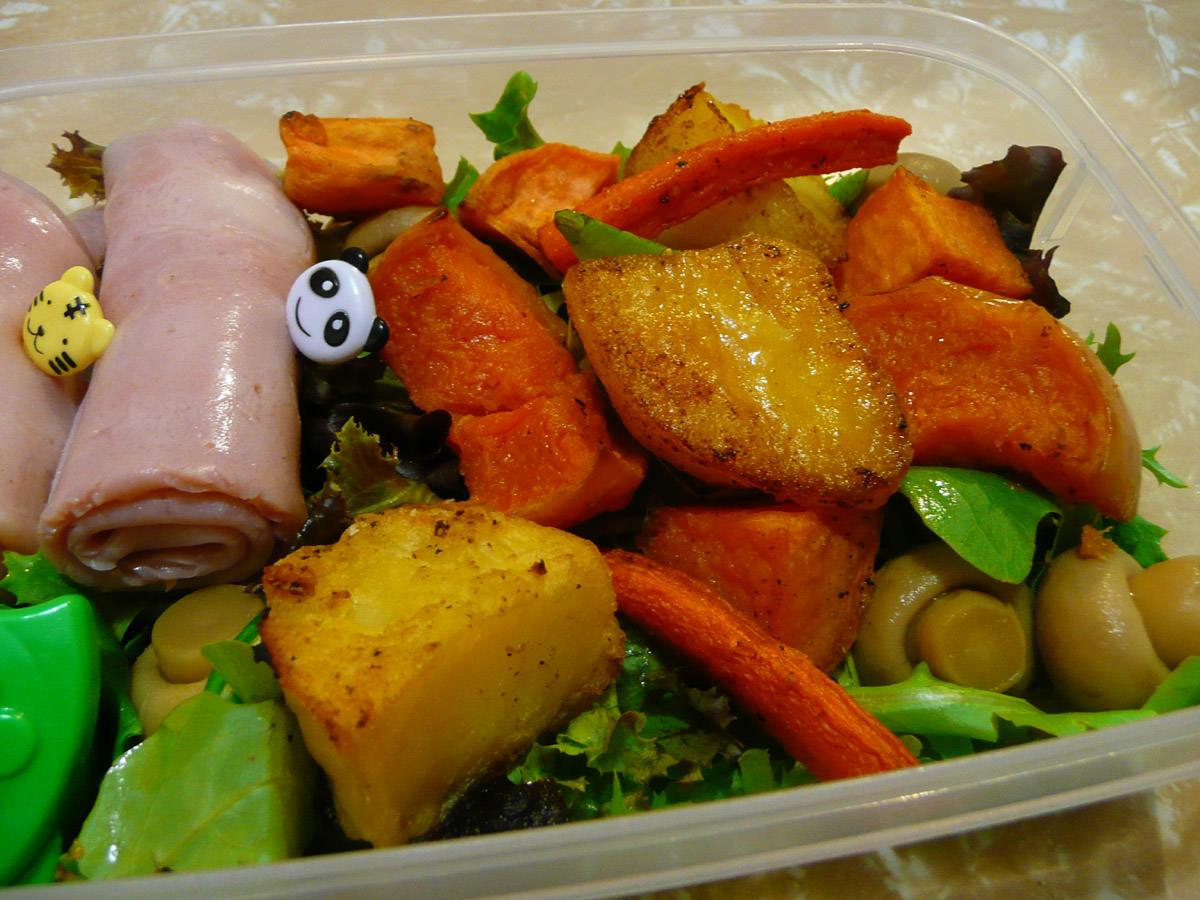 Honey-glazed ham, roasted vegetables and salad bento close-up
