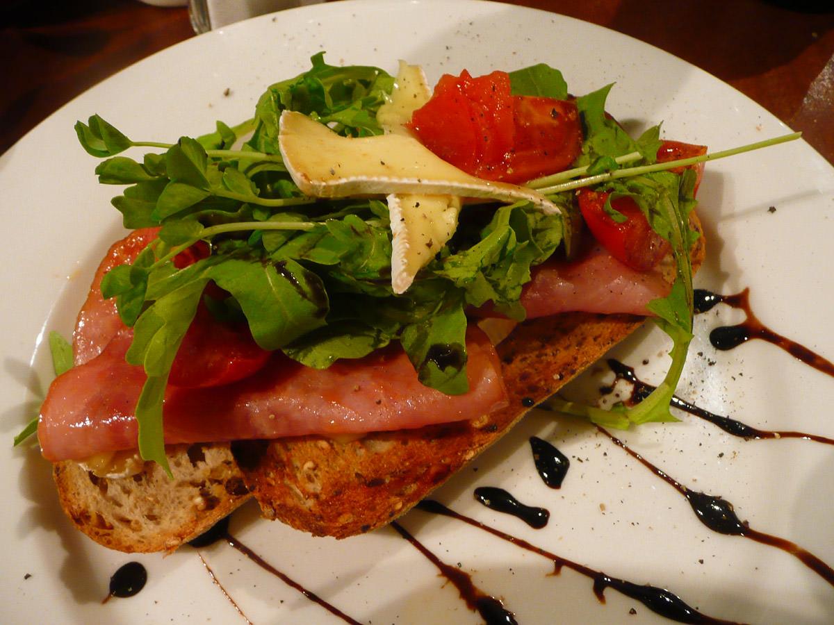 Honey glazed ham, roasted tomato, rocket and brie on toast