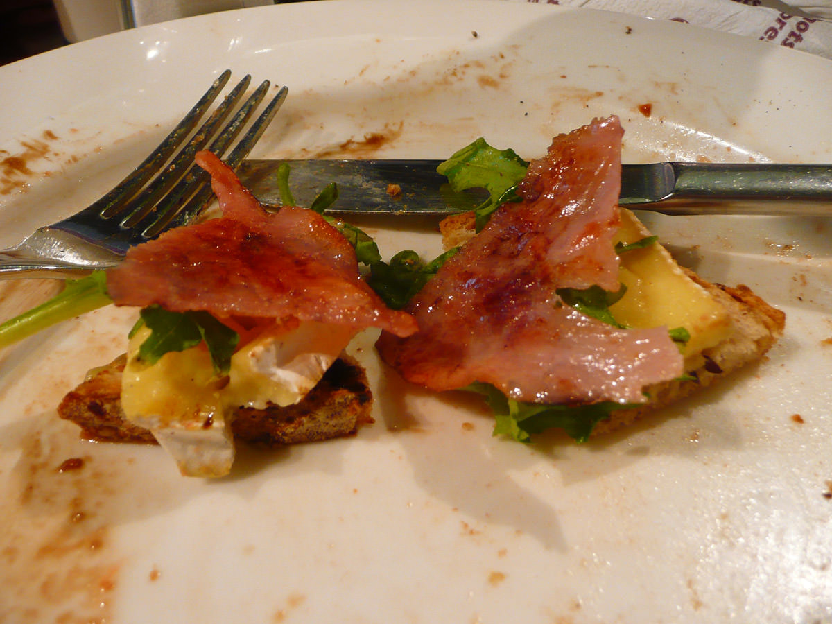 Two mouthfuls left - toast, brie, rocket and ham
