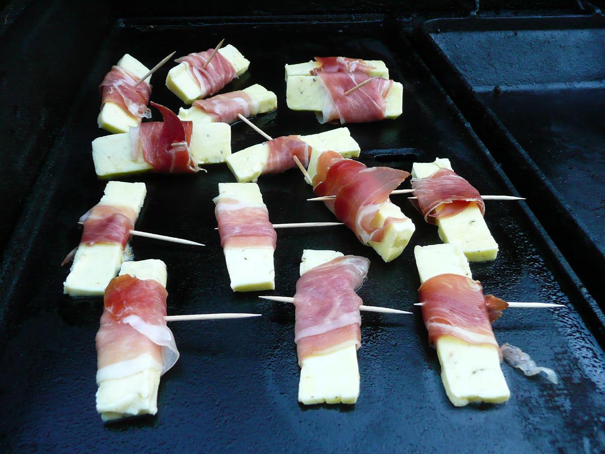 Haloumi wrapped in prosciutto on the barbecue