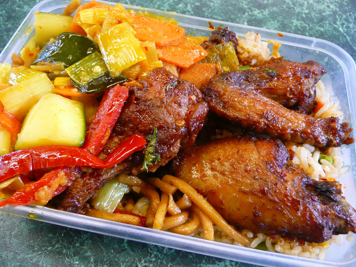 Curried vegetables, chilli chicken wings, noodles and fried rice