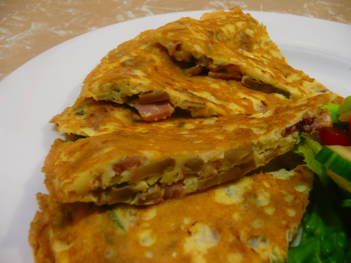 Omelette with bacon, mushrooms, garlic and onion - close-up