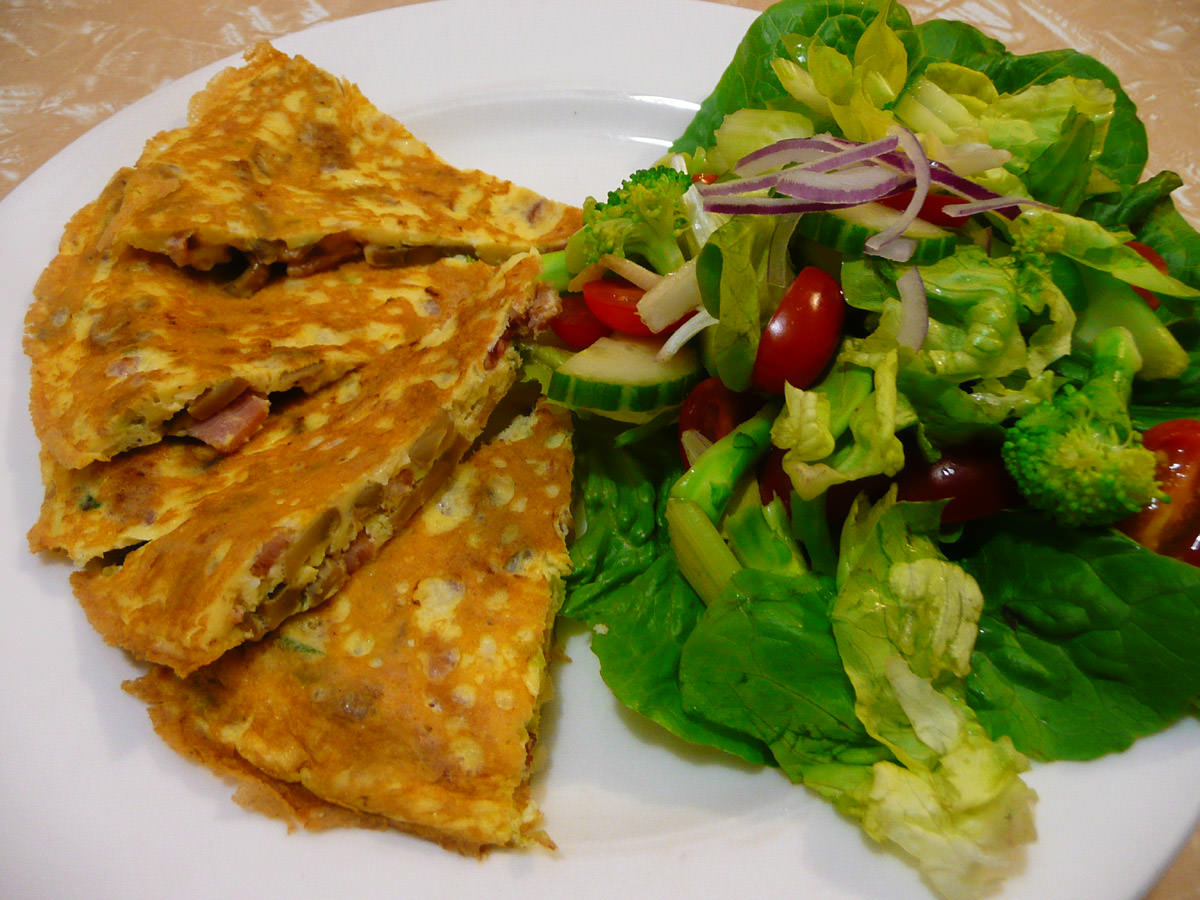 Omelette with bacon, mushrooms, garlic and onion, served with salad