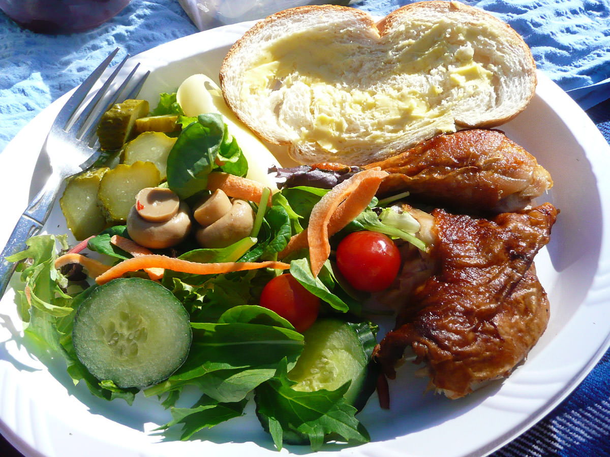Chicken, salad, bread and pickles