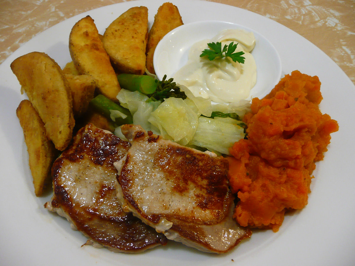 Pork steaks, orange mash, potato wedges, steamed greens and aioli