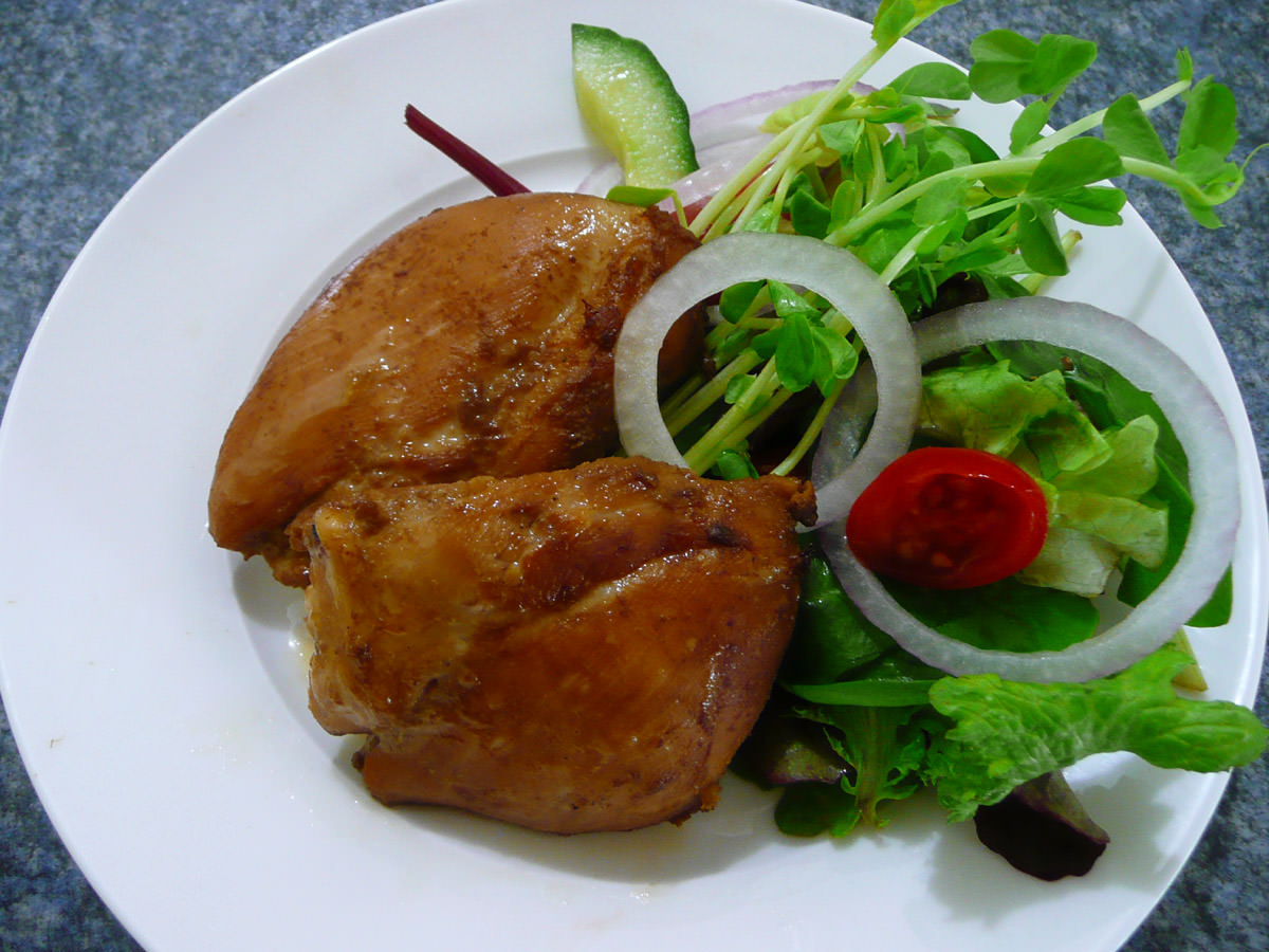 Marinated chicken thighs with salad
