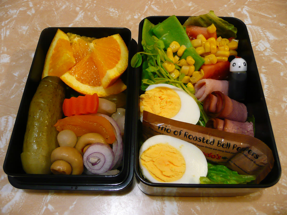 Jac's bento - hard-boiled egg, cold meats, pickles, salad and fruit