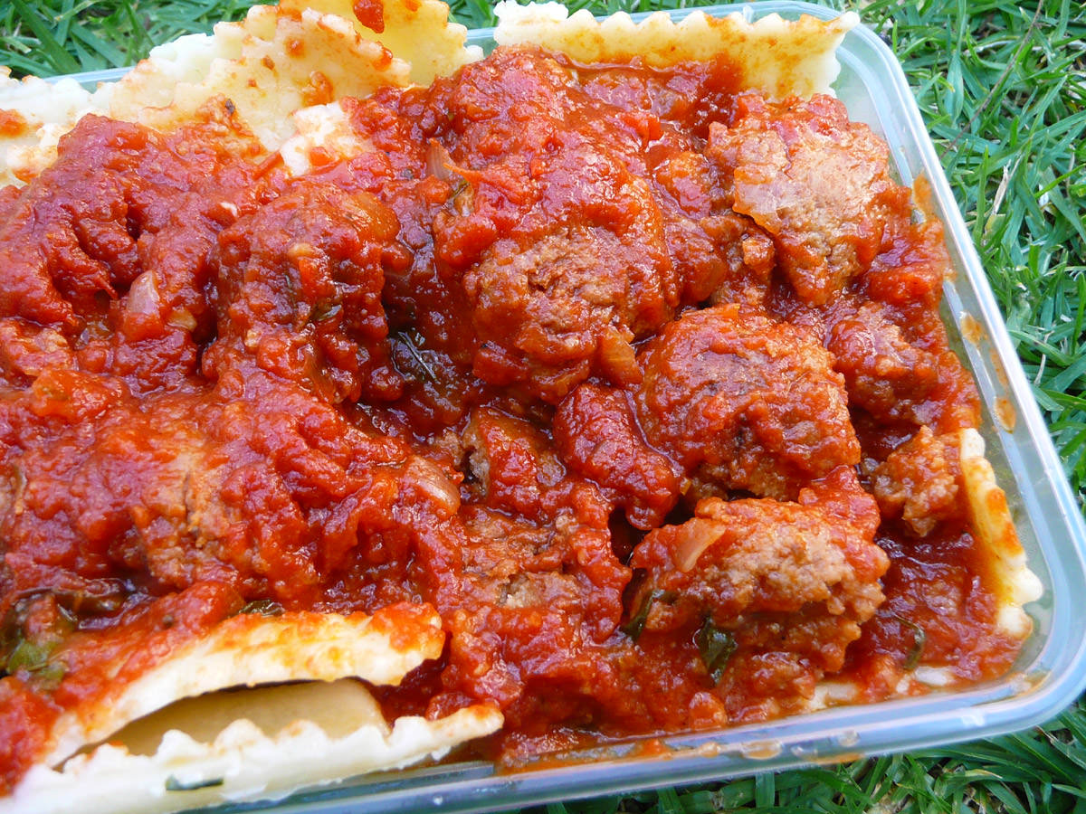 Spinach and ricotta ravioli with meatball sauce