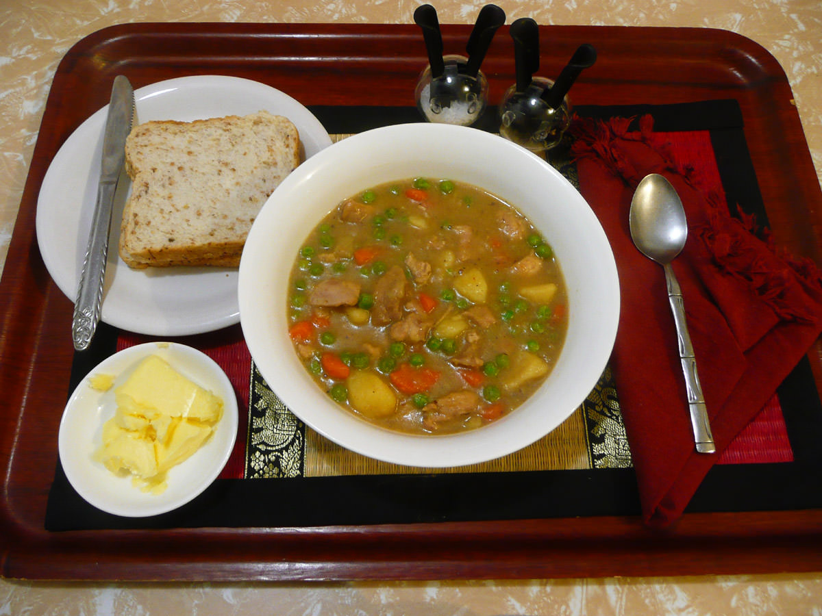 Chicken stew with bread and butter