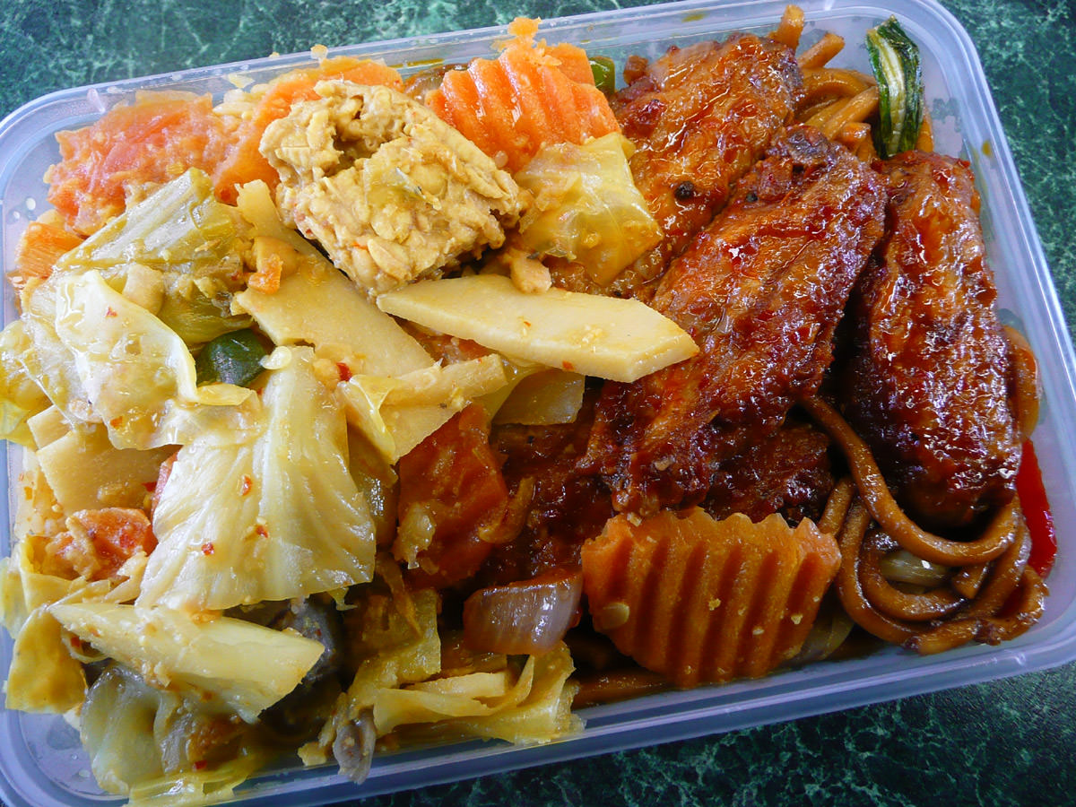 Chilli chicken, curried vegetables and noodles