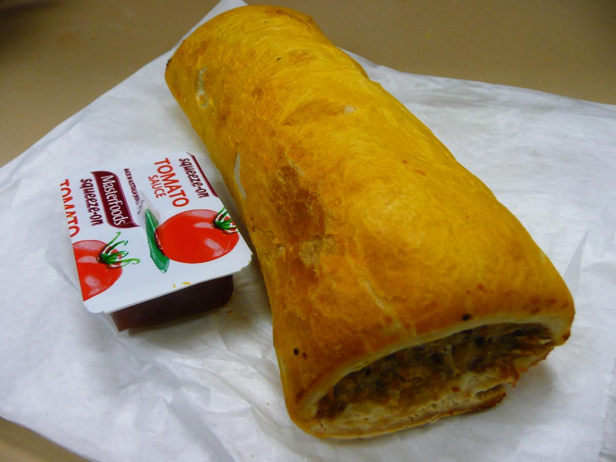 Sausage roll and tomato sauce