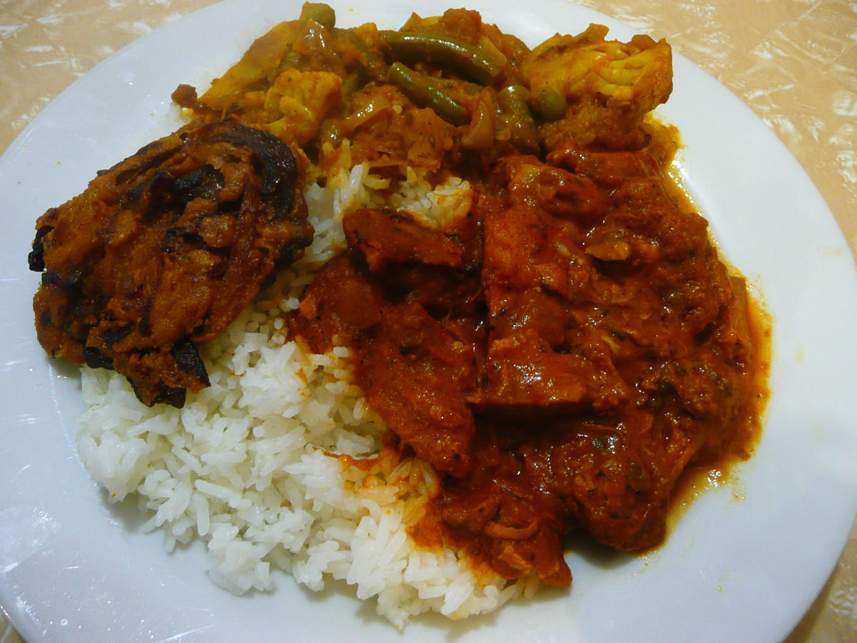Onion bhaji, vegetable and potato curries, butter chicken and rice