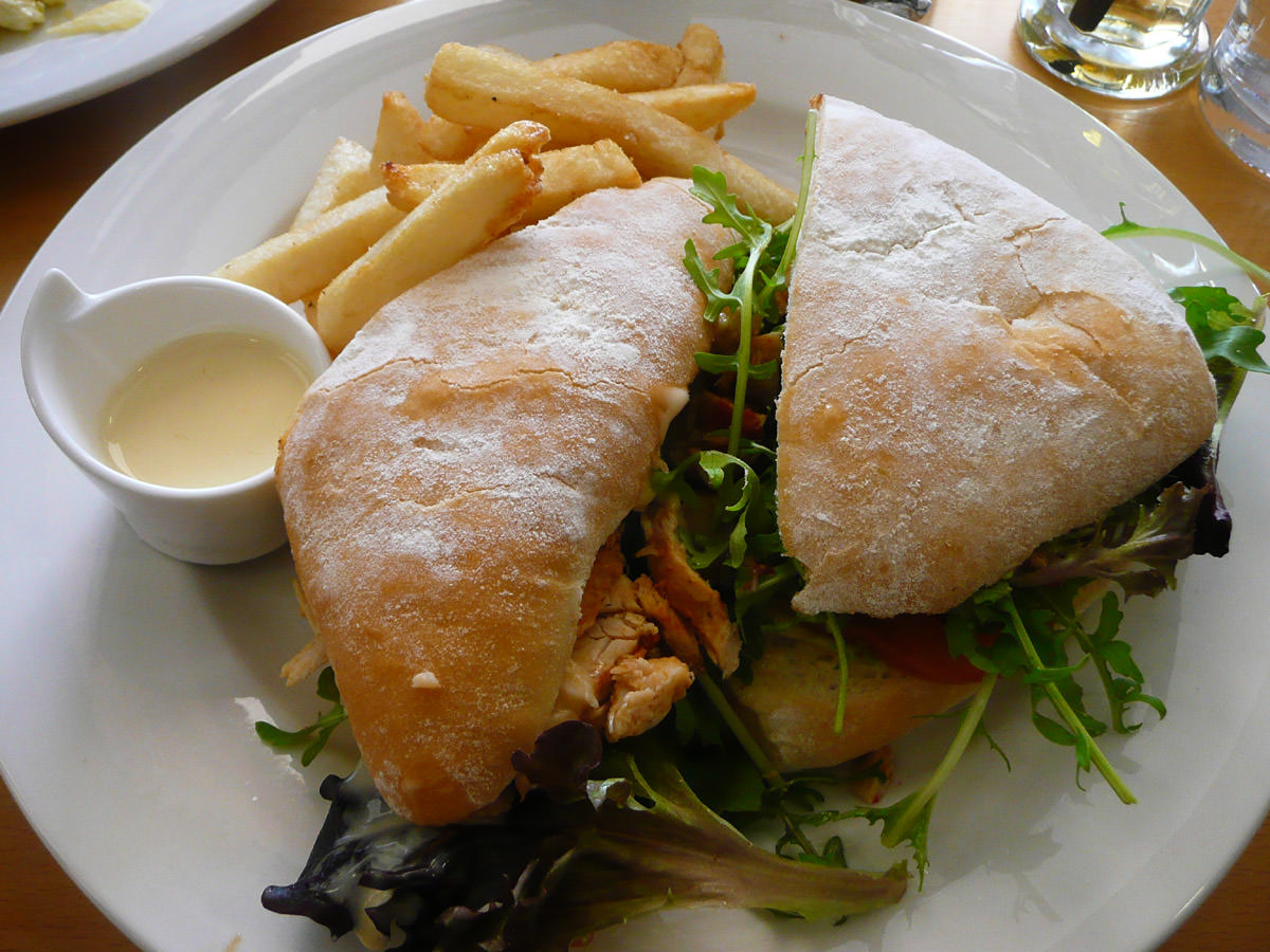 Chicken and avocado panini with chips and aioli