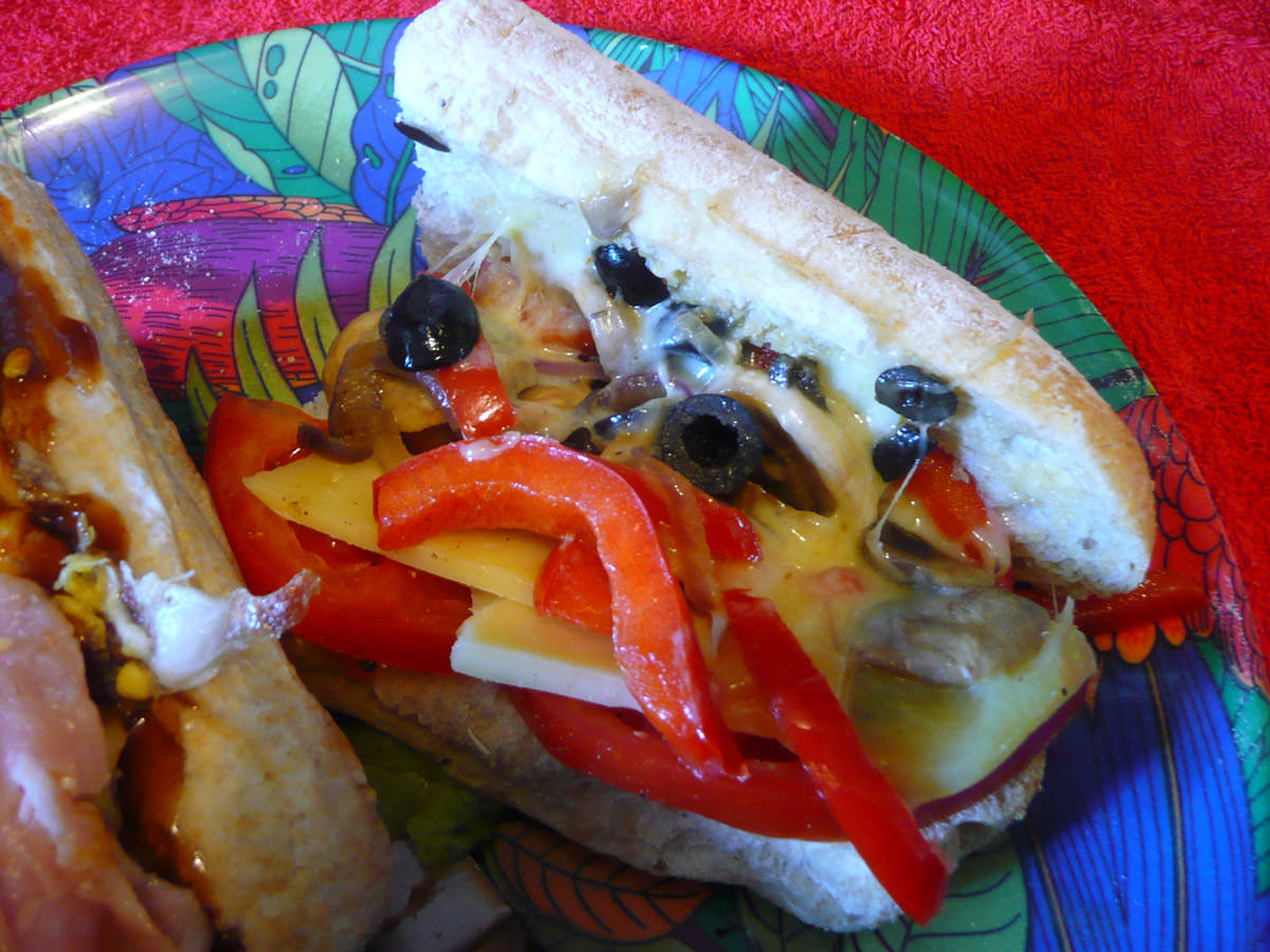 Tomato, capsicum, onions, mushrooms olives and cheese