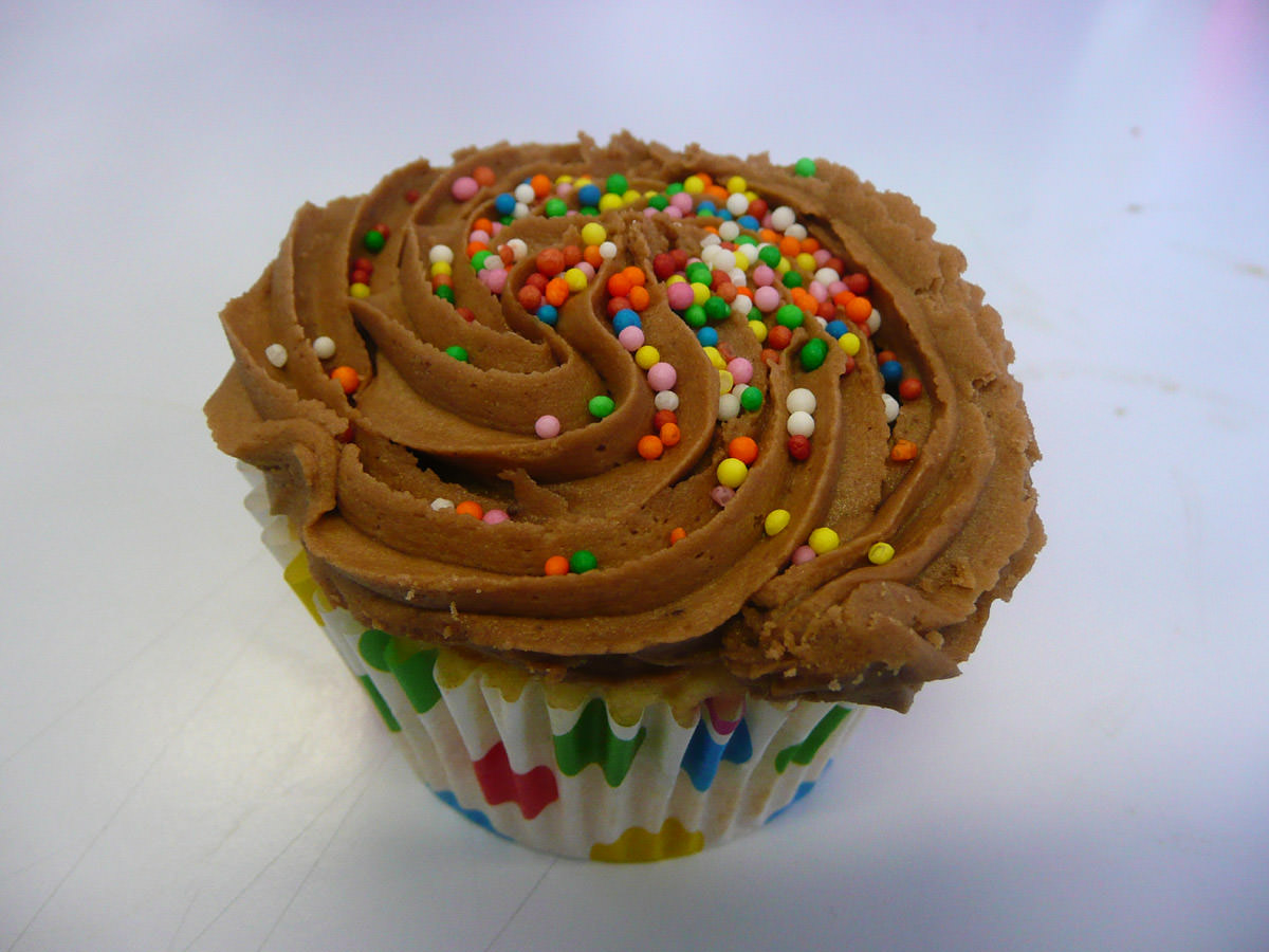 Cupcake with choc icing and hundreds and thousands
