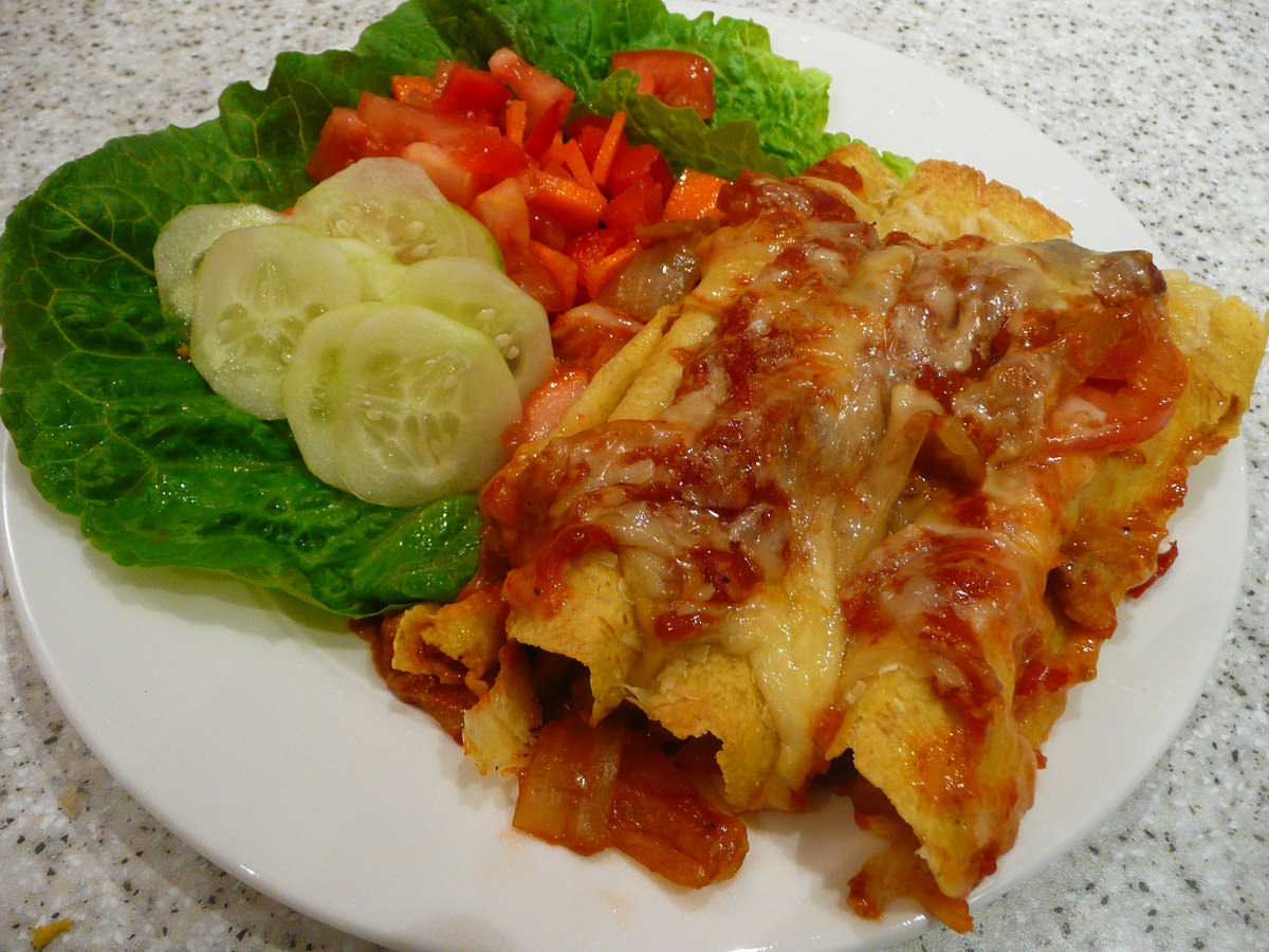 Chicken enchiladas with salad