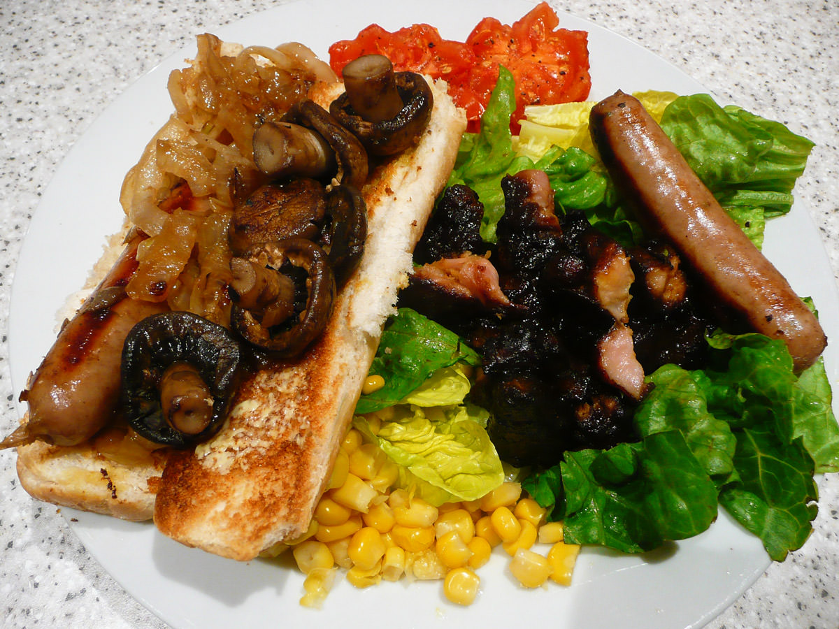 Sausage sizzle with mushrooms and salad