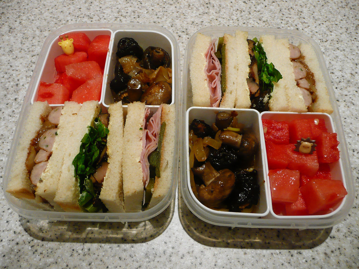 Bento lunches for two - sandwiches, onions and mushrooms, watermelon