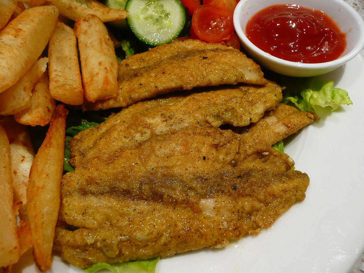 Curried fried herring fillets - close-up