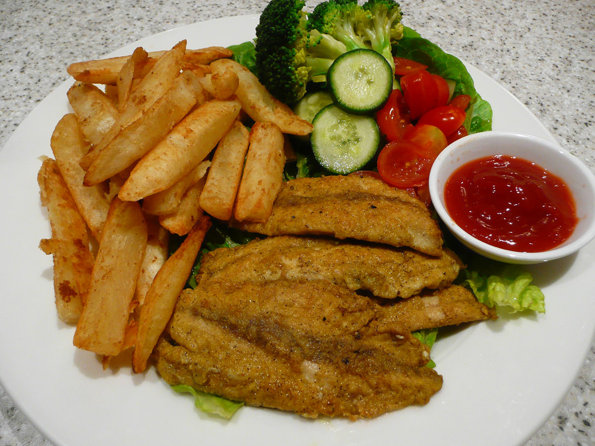 Curried fried herring fillets, salad and chips