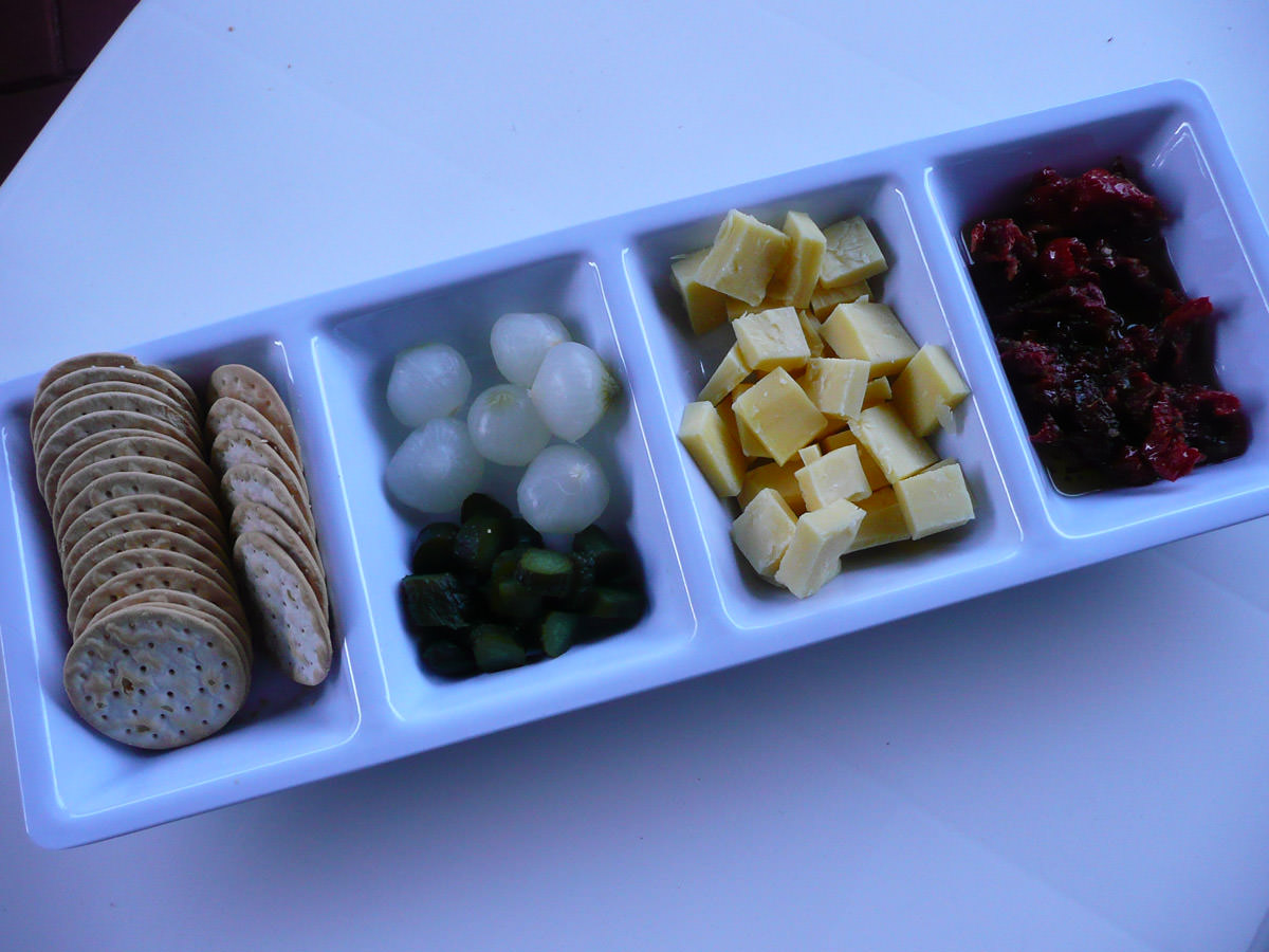 Crackers, pickles, cheese and semi-sundried tomatoes