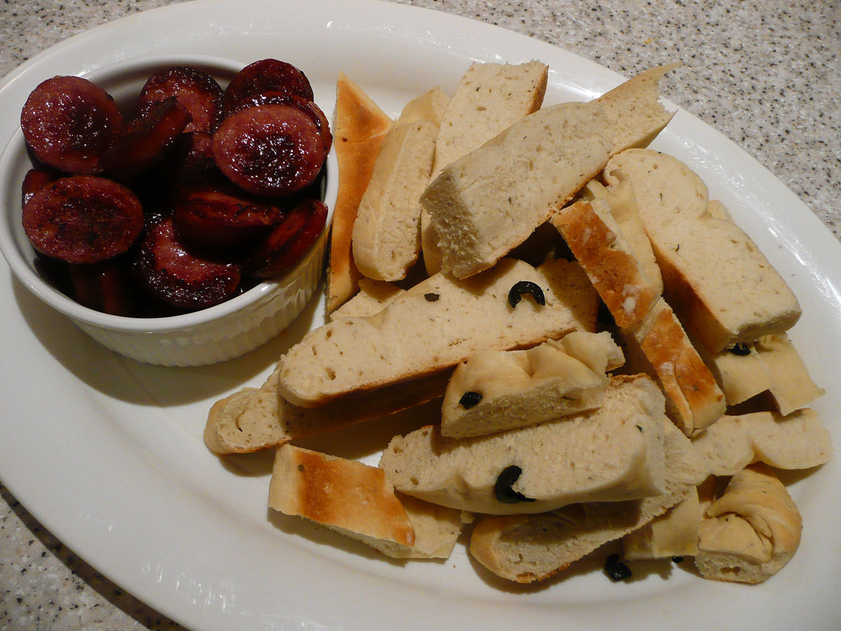 Fried sausage and toasted olive bread
