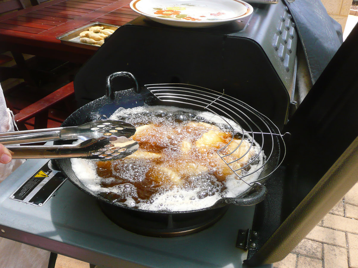 Frying the curry puffs
