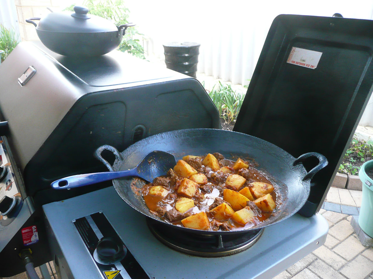 Kangaroo vindaloo on the BBQ wok burner