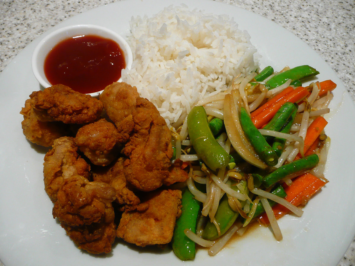 Fried chicken, ginger vegetable stir-fry, tomato sauce and rice