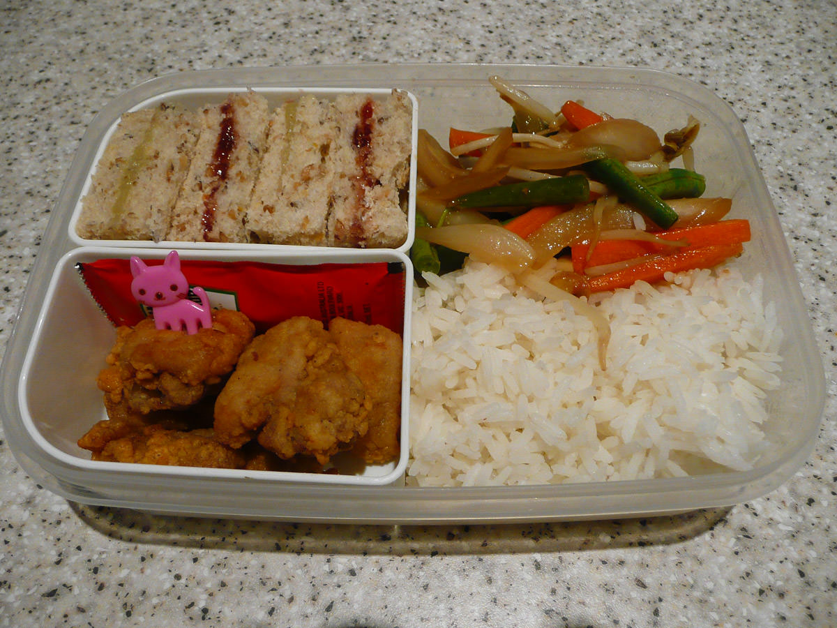 My bento lunch - fried chicken, tomato sauce, rice, ginger vegetable stir-fry and mini jam and kaya sandwiches