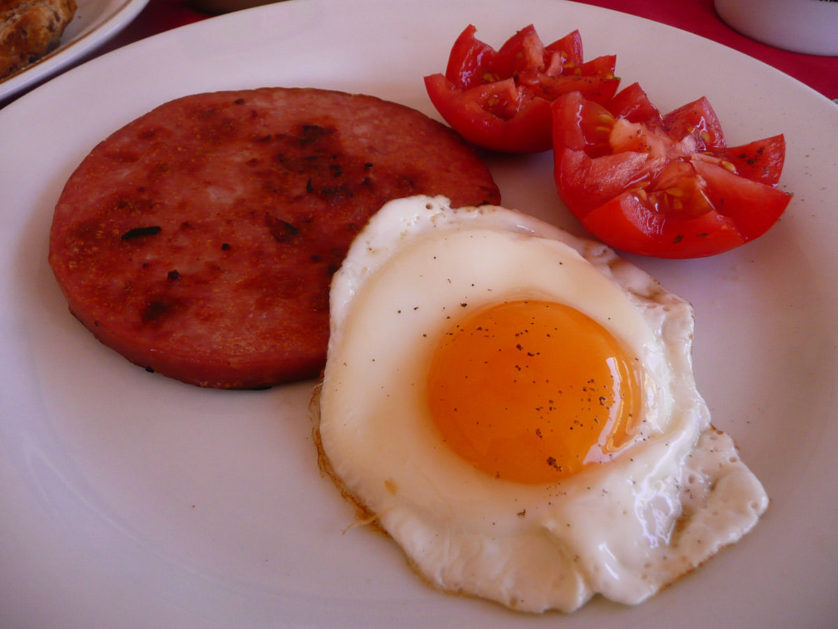 Ham steak, fried egg and tomatoes