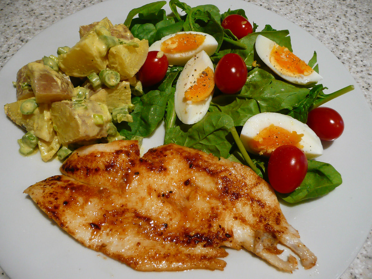 Panfried fish, curried potato salad and garden salad