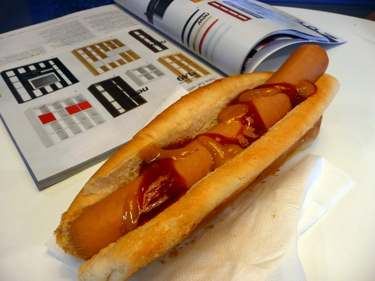 Jac is reading the IKEA catalogue while I photograph my hot dog