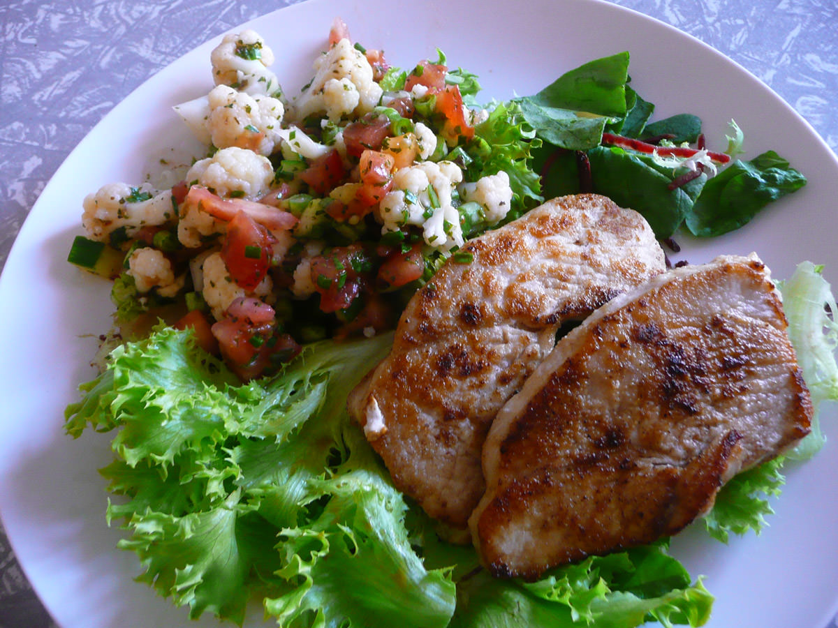 Turkey breast steaks with cauliflower salad