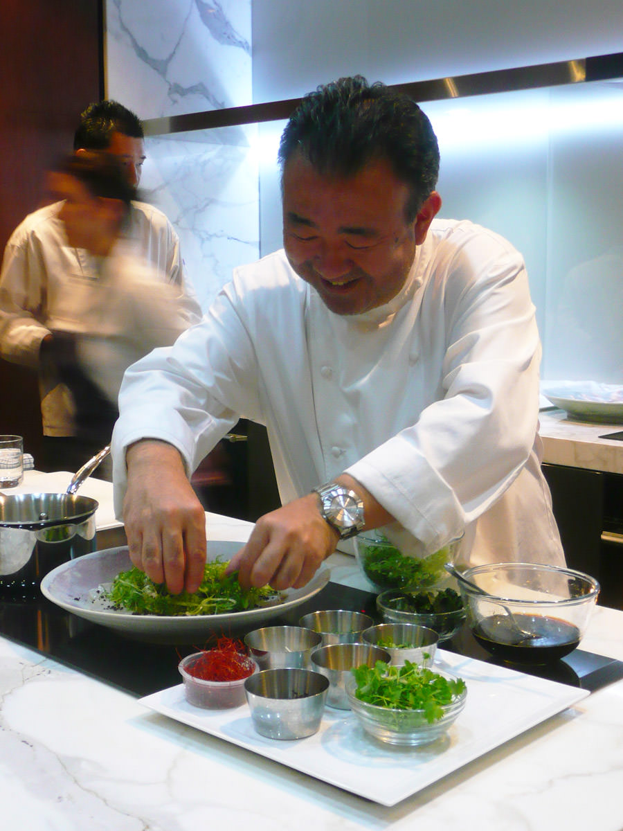 Tetsuya grins as he prepares the scallop salad