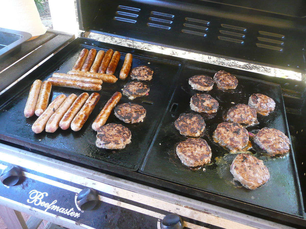 Burger patties and sausages on the barbecue