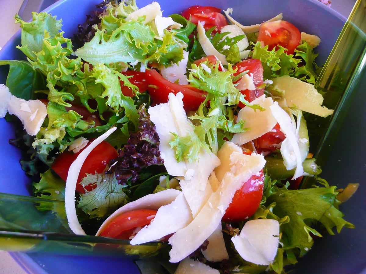 Garden salad with shaved parmesan cheese